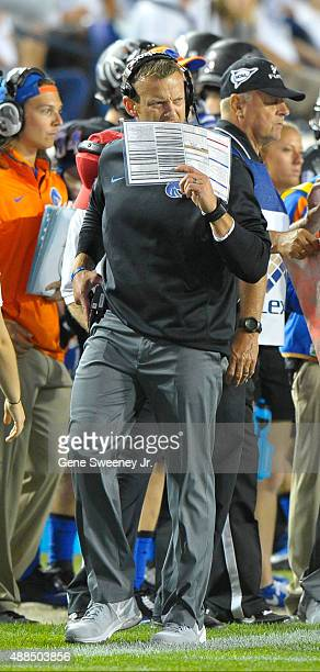 Head coach Bryan Harsin of the Boise State Broncos walks the sidelines during their game against the Brigham Young Cougars at LaVell Edwards Stadium...