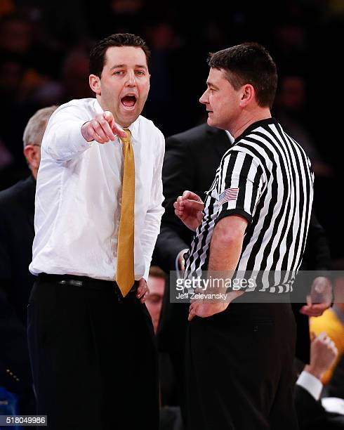 Head coach Bryce Drew of the Valparaiso Crusaders talks to an official during their NIT Championship Semifinal game against the Brigham Young Cougars...