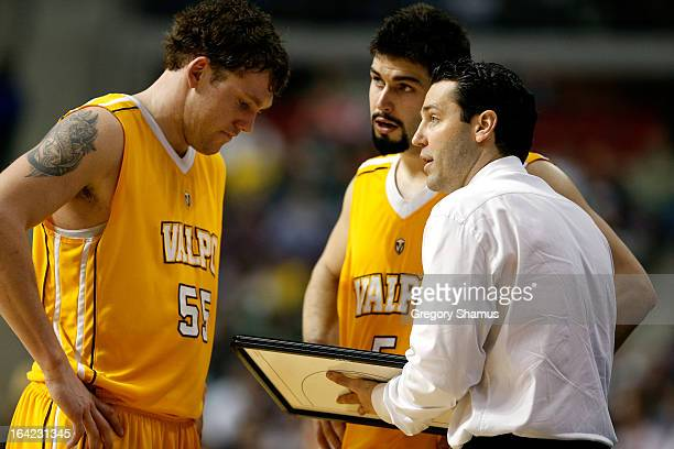 Head coach Bryce Drew of the Valparaiso Crusaders talks with Kevin Van Wijk and Bobby Capobianco against the Michigan State Spartans during the...