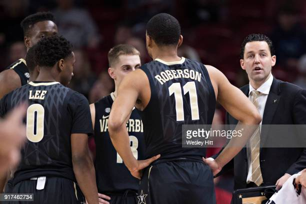 Head Coach Bryce Drew of the Vanderbilt Commodores huddles with his team during a game against the Arkansas Razorbacks at Bud Walton Arena on...