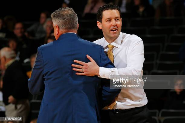 Head coach Bryce Drew of the Vanderbilt Commodores hugs head coach Bruce Pearl of the Auburn Tigers after a 6453 Auburn victory at Memorial Gym on...