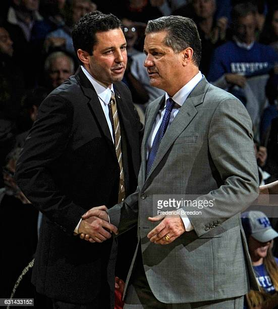 Head coach Bryce Drew of the Vanderbilt Commodores shakes hands with head coach John Calipari of the Kentucky Wildcats after an 8781 Kentucky victory...