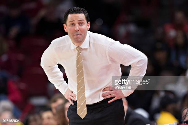 Head Coach Bryce Drew of the Vanderbilt Commodores stares down the officials during a game against the Arkansas Razorbacks at Bud Walton Arena on...