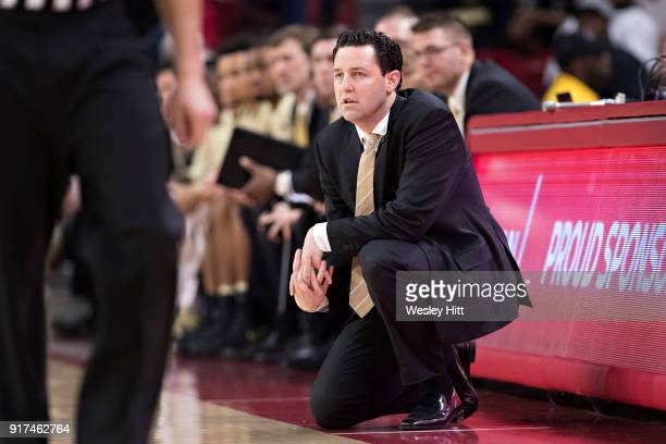 Head Coach Bryce Drew of the Vanderbilt Commodores watches his team play during a game against the Arkansas Razorbacks at Bud Walton Arena on...