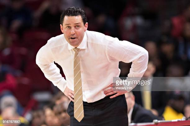 Head Coach Bryce Drew of the Vanderbilt Commodores yells to the official during a game against the Arkansas Razorbacks at Bud Walton Arena on...