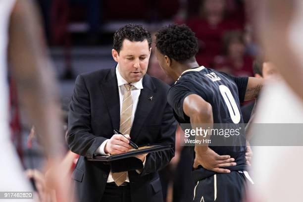 Head Coach Bryce Drew talks with Saben Lee of the Vanderbilt Commodores on the sidelines during a game against the Arkansas Razorbacks at Bud Walton...