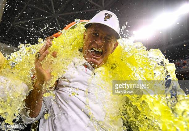 Head coach Butch Davis of the FIU Golden Panthers gets a Gatorade shower after the victory over the Miami Hurricanes at Marlins Park on November 23...