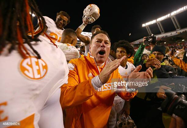 Head coach Butch Jones of the Tennessee Volunteers celebrates with his team after defeating the South Carolina Gamecocks 4542 in overtime at...