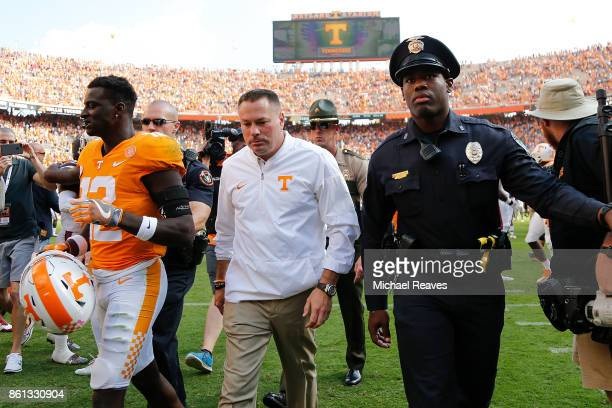 Head coach Butch Jones of the Tennessee Volunteers walks off the field after the game against the South Carolina Gamecocks at Neyland Stadium on...