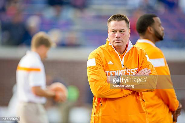 Head coach Butch Jones of the Tennessee Volunteers watches his team warm up prior to their game against the Mississippi Rebels on October 18 2014 at...
