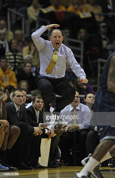 Head coach Buzz Williams of the Marquette Golden Eagles leaps in the air as he calls a play for his team against the Georgetown Hoyas at the Bradley...