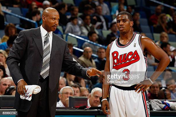 Head coach Byron Scott and Chris Paul of the New Orleans Hornets speaks during a timeout against the Charlotte Bobcats at the New Orleans Arena...