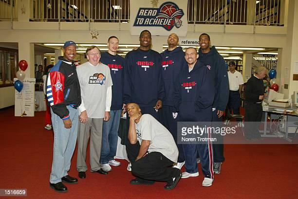 Head coach Byron Scott Rod Thorn President and General Manager of the New Jersey Nets Aaoron Williams Dikembe Mutombo Kenyon Martin Jason Kidd Jason...