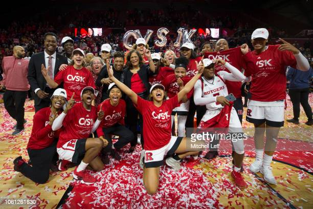 Head coach C. Vivian Stringer of the Rutgers Scarlet Knights celebrates her 1,000 career win with her team after defeating the Central Connecticut...