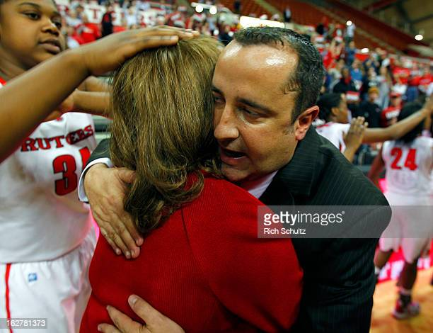 Head coach C Vivian Stringer of the Rutgers Scarlet Knights is hugged by Head coach Jose Fernandez of the South Florida Bulls after Rutgers defeated...