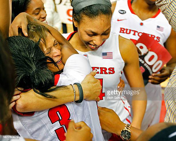 Head coach C Vivian Stringer of the Rutgers Scarlet Knights is mobbed by her players and hugged by Erica Wheeler after defeating the South Florida...