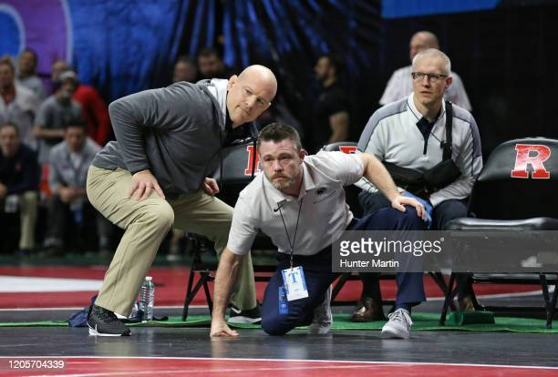 Head coach Cael Sanderson and assistant coach Cody Sanderson of the Penn State Nittany Lions coach a match during the Big Ten Championships at...