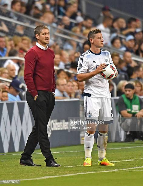 Head coach Carl Robinson of the Vancouver Whitecaps FC talks with defender Fraser Aird against Sporting Kansas City during the first half on August...