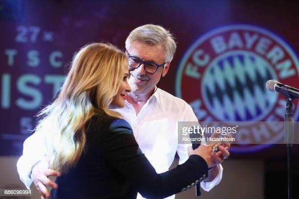 Head coach Carlo Ancelotti and Anastacia perform on stage during the FC Bayern Muenchen Championship party following the Bundesliga match between...