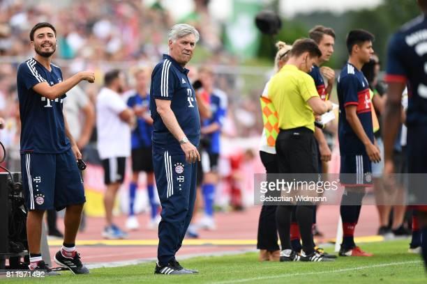Head coach Carlo Ancelotti and assistant coach Davide Ancelotti gesture during the preseason friendly match between FSV ErlangenBruck and Bayern...
