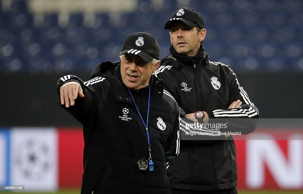 Head coach Carlo Ancelotti (L) and assistant coach Paul Clement of Real Madrid attend a training session at Veltins-Arena on February 17, 2015 in Gelsenkirchen, Germany.
