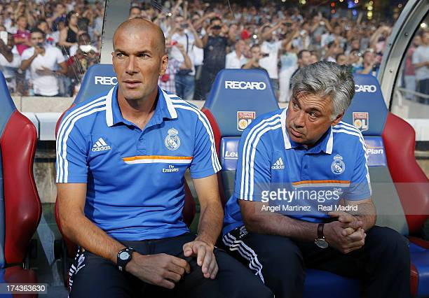 Head coach Carlo Ancelotti and assistant coach Zinedine Zidane of Real Madrid look on during the preseason friendly match between Olympique Lyonnais...