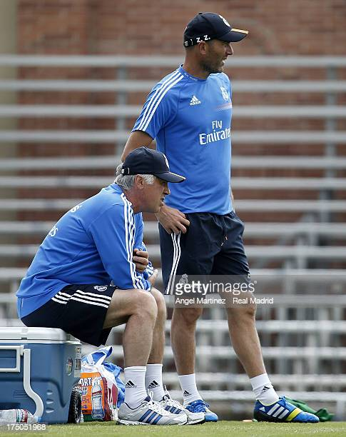 Head coach Carlo Ancelotti and assistant coach Zinedine Zidane of Real Madrid follow their players during a training session at UCLA Campus on July...