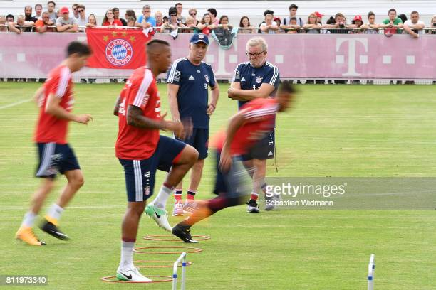 Head coach Carlo Ancelotti and fitness coache Giovanni Mauri of FC Bayern Muenchen watch players run during a training session at Saebener Strasse...