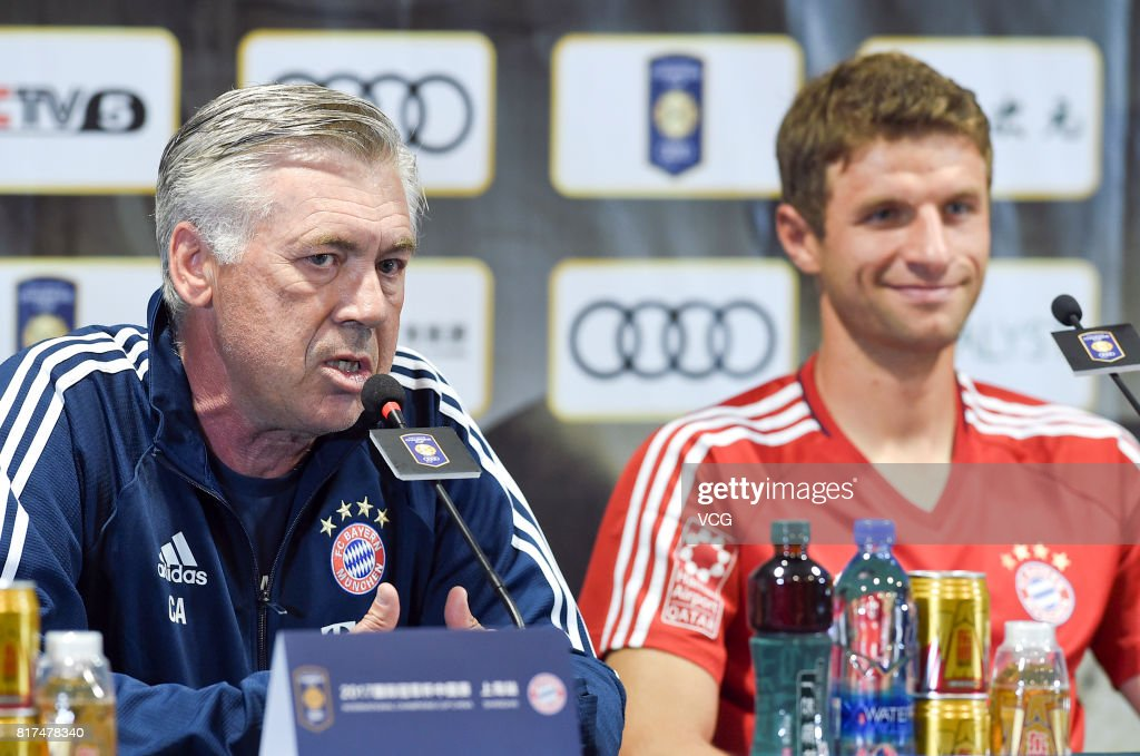 Head coach Carlo Ancelotti (L) and forward Thomas Mueller of FC Bayern Muenchen attend a press conference at Shanghai Stadium ahead of 2017 International Champions Cup China on July 18, 2017 in Shanghai, China.