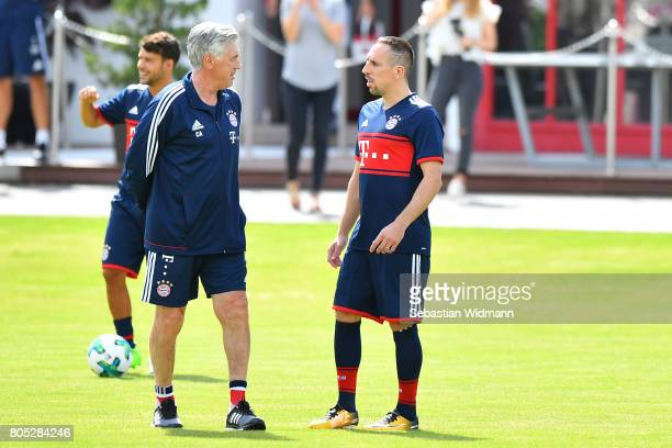 Head coach Carlo Ancelotti and Franck Ribery of FC Bayern Muenchen talk at the beginning of a training session at Saebener Strasse training ground on...