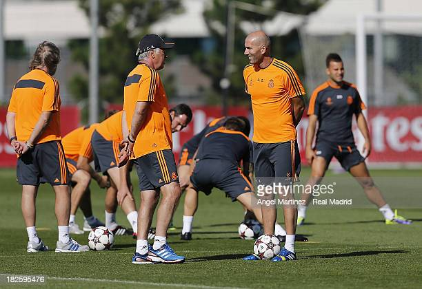 Head coach Carlo Ancelotti and his assistant Zinedine Zidane of Real Madrid chat during a training session ahead of their UEFA Champions League match...