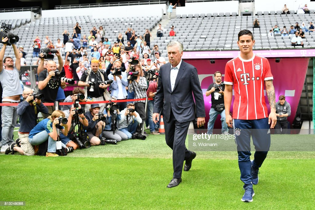 Head coach Carlo Ancelotti and James Rodriguez of FC Bayern Muenchen walk on the pitch of the Allianz Arena on July 12, 2017 in Munich, Germany.