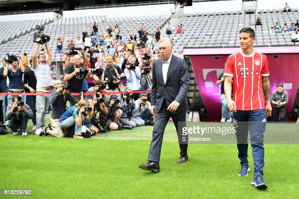 Head coach Carlo Ancelotti and James Rodriguez of FC Bayern Muenchen walk on the pitch of the Allianz Arena on July 12 2017 in Munich Germany