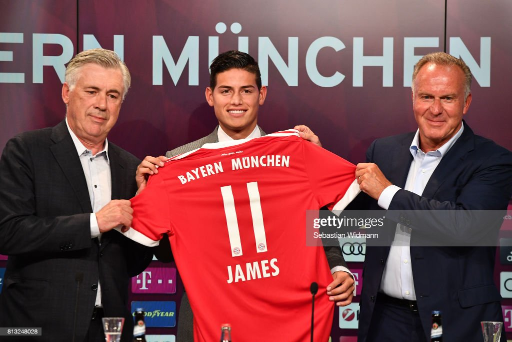 Head coach Carlo Ancelotti (L) and Karl-Heinz Rummenigge, CEO of FC Bayern Muenchen present James Rodriguez with his new jersey during a press conference at Allianz Arena on July 12, 2017 in Munich, Germany.