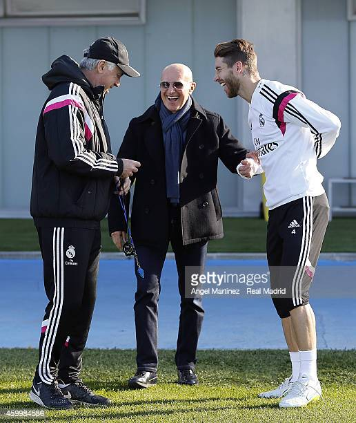 Head coach Carlo Ancelotti and Sergio Ramos of Real Madrid talk with former Italian coach Arrigo Sacchi during a training session at Valdebebas...