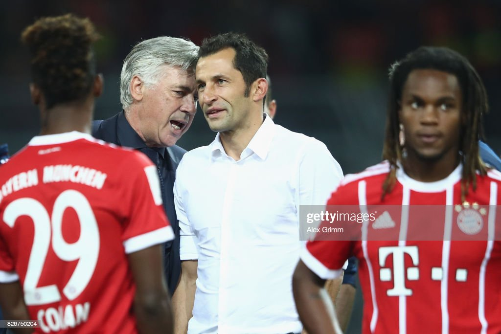 Head coach Carlo Ancelotti and sports director Hasan Salihamidzic chat after their team won the DFL Supercup 2017 match between Borussia Dortmund and Bayern Muenchen at Signal Iduna Park on August 5, 2017 in Dortmund, Germany.