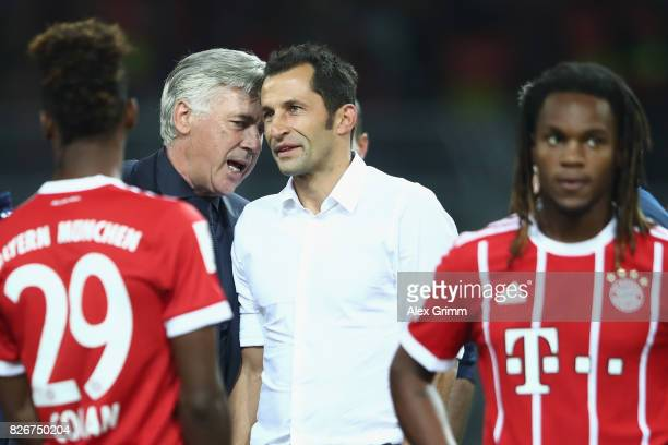 Head coach Carlo Ancelotti and sports director Hasan Salihamidzic chat after their team won the DFL Supercup 2017 match between Borussia Dortmund and...