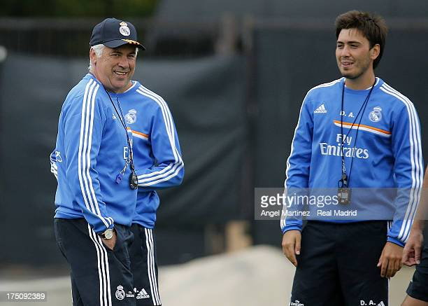 Head coach Carlo Ancelotti and trainer Davide Ancelotti of Real Madrid look on during a training session at UCLA Campus on July 31 2013 in Los...