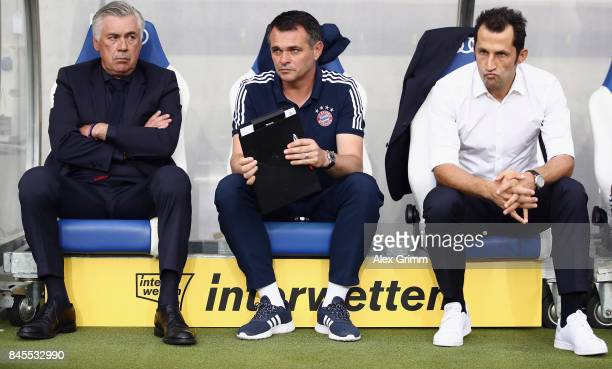 Head coach Carlo Ancelotti assistant coach Willy Sagnol and sport director Hasan Salihamidzic of Muenchen look on prior to the Bundesliga match...