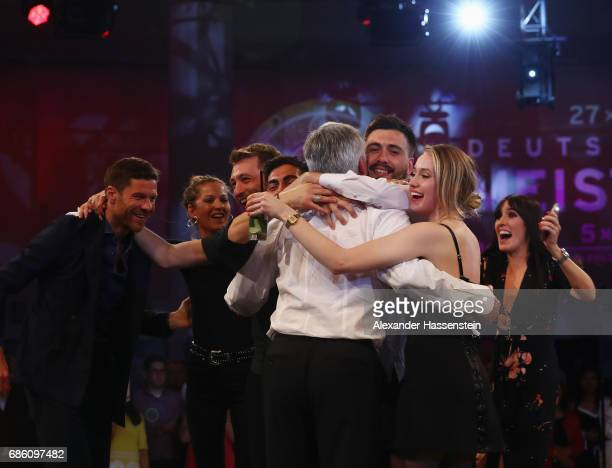 Head coach Carlo Ancelotti is hugged by his son Davide Ancelotti during the FC Bayern Muenchen Championship party following the Bundesliga match...