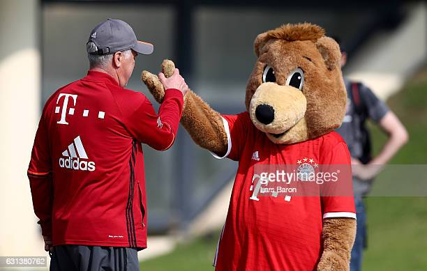Head coach Carlo Ancelotti is seen with mascot Bernie during a training session at day 8 of the Bayern Muenchen training camp at Aspire Academy on...