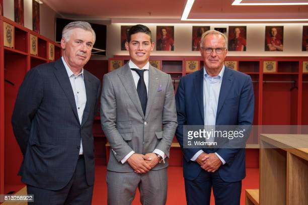 Head coach Carlo Ancelotti James Rodriguez and KarlHeinz Rummenigge CEO of FC Bayern Muenchen pose for a picture in the dressing room of the Allianz...