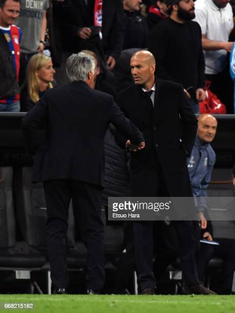 Head coach Carlo Ancelotti of Bayern Muenchen and head coach Zinedine Zidane of Real Madrid shake hands after during the UEFA Champions League...