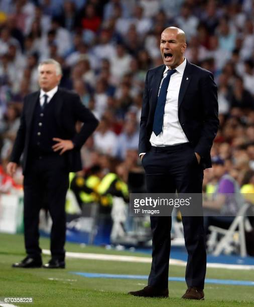 Head coach Carlo Ancelotti of Bayern Muenchen and Head coach Zinedine Zidane of Real Madrid looks on during the UEFA Champions League Quarter Final...