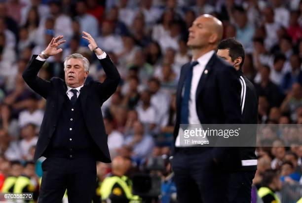 Head coach Carlo Ancelotti of Bayern Muenchen and Head coach Zinedine Zidane of Real Madrid gestures during the UEFA Champions League Quarter Final...