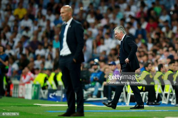 Head coach Carlo Ancelotti of Bayern Muenchen reacts behind head coach Zinedine Zidane of Real Madrid CF during the UEFA Champions League Quarter...