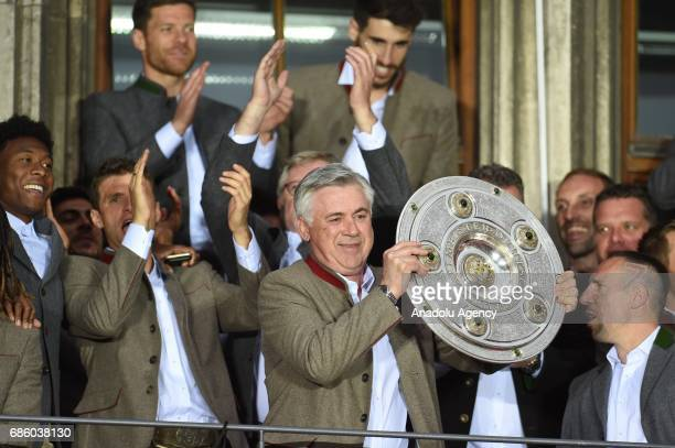 Head Coach Carlo Ancelotti of Bayern Munich celebrates winning the German soccer championship with the trophy on a balcony of the town hall in Munich...