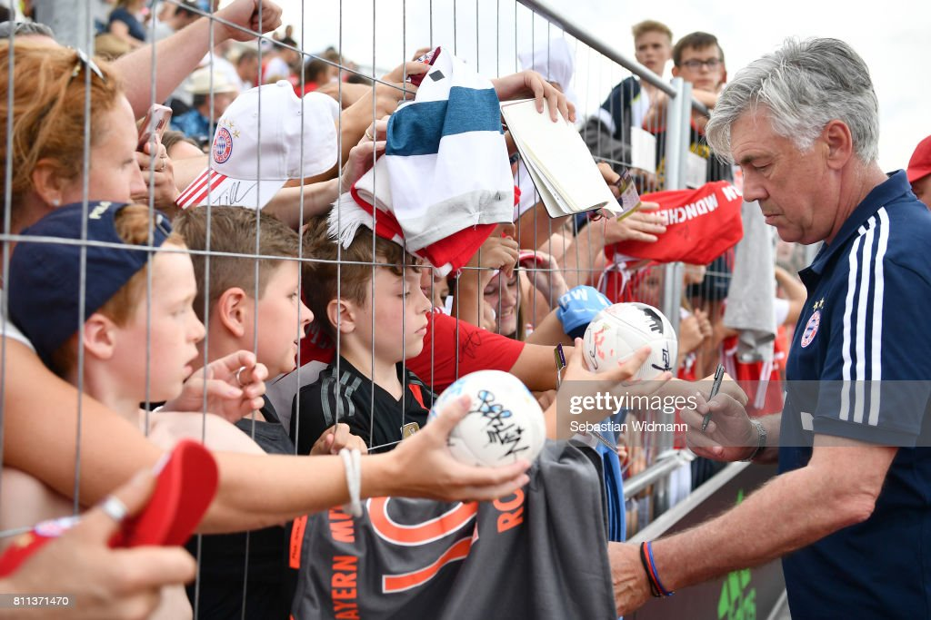 Head coach Carlo Ancelotti of FC Bayern Muenchen gives autographs after the preseason friendly match between FSV Erlangen-Bruck and Bayern Muenchen at Adi Dassler Sportplatz on July 9, 2017 in Herzogenaurach, Germany.