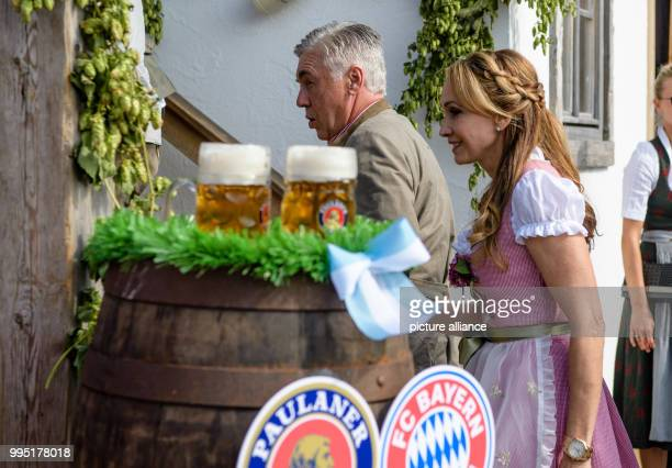 Head coach Carlo Ancelotti of FCBayern Munich arrives at the Kaeferzelt tent with his wife Mariann Barrena McClay at the Theresienwiese in Munich...