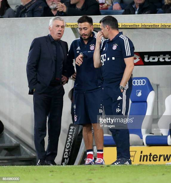 Head coach Carlo Ancelotti of Muenchen and Cocoach Willy Sagnol of Muenchen and Davide Ancelotti of Muenchen looks on during the Bundesliga match...